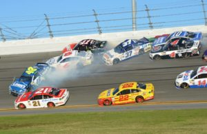A big wreck unfolds in turn 3 of the Daytona 500, with Jimmie Johnson spinning at the front of the pack. [Kim Kemperman Photo]