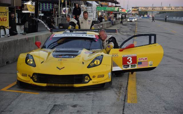 Dan Binks makes adjustments to the winning Corvette.  [Photo by Jack Webster]