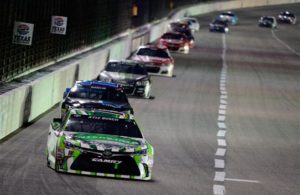 Kyle Busch leads a pack of cars at Texas Motor Speedway in 2016. [Photo by Robert Laberge/NASCAR via Getty Images]