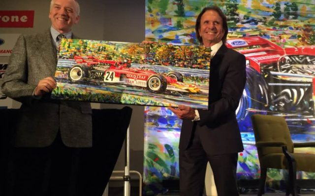 Artist Randy Lewis and Emerson Fittipaldi with Randy's painting of the Lotus 72.  [Photo by Eddie LePine]