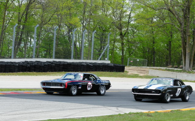 #96 Daniel Parr (CAMARO Z28) and #47 Tom Comelius (CAMARO Z28) battle for position in turn 6 during running of Group 6 12 Carl Jensen Memorial race on Sunday at Road America.  [Dave Jensen Photo]