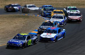 Jimmie Johnson leads a pack of cars during the 2016 Toyota/Save Mart 350 at Sonoma Raceway. [Photo by Chris Trotman/NASCAR via Getty Images]