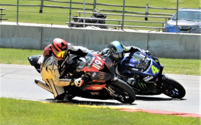 #119 Stefan Dollpsski (BMW S1000RR) and #4 Josh Hayes (YAMAHA YZF-R1) in turn 3 at Road America on Friday.  [Dave Jensen Photo]