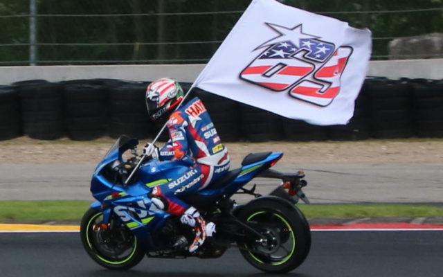 Roger Hayden cicled the Road America track with a #69 flag to honor the loss of his brother Nicky.  [Tim Crosslen Photo]