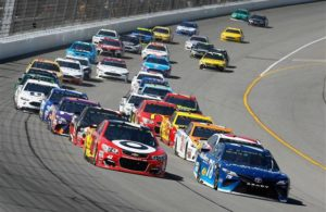 Martin Truex Jr. and Kyle Larson lead a pack of Monster Energy NASCAR Cup Series drivers. [Photo by Brian Lawdermilk/Getty Images]