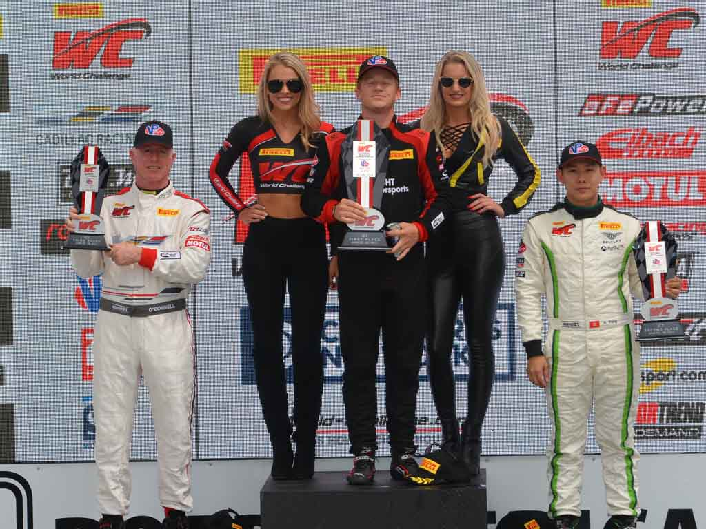 Johnny O'Connell (3rd place), Patrick Long (Winner) and Adderly Fong (2nd place) on the Pirelli World Challenge podium. [Dave Jensen Photo]
