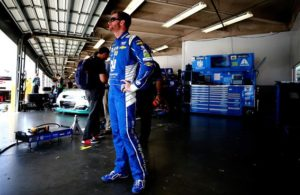 Dale Earnhardt Jr. stands in the garage area during practice for the Monster Energy NASCAR Cup Series 59th Annual Coke Zero 400 Powered By Coca-Cola at Daytona International Speedway. [Photo by Sean Gardner/Getty Images]