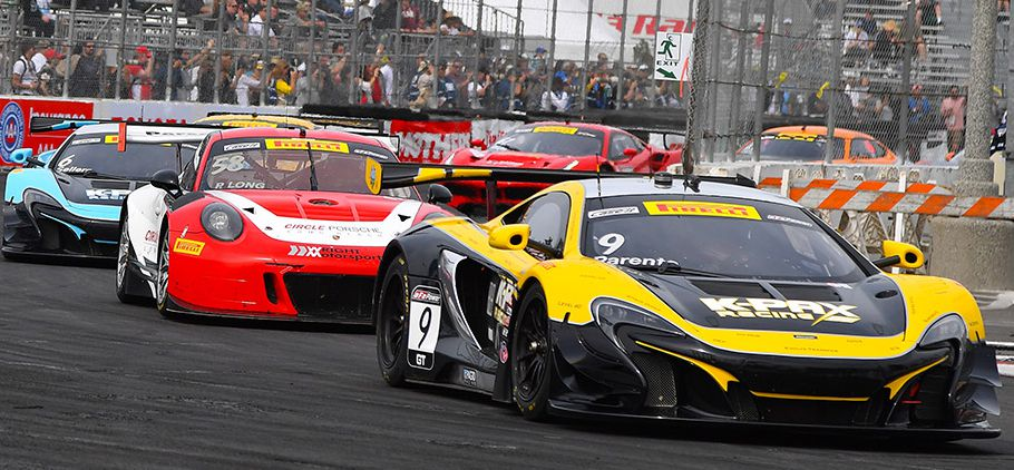 Alvaro Parente leads Patrick Long at the Long Beach Grand Prix.  [photo courtesy Pirelli World Challenge Championship]