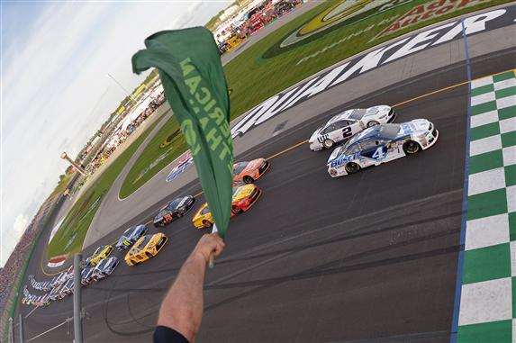 The field sees the green flag to start the 2016 Quaker State 400 at Kentucky Speedway. [Photo by Drew Hallowell/NASCAR via Getty Images]