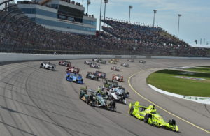 Simon Pagenaud and Josef Newgarden lead the field into Turn 1 during the Iowa Corn 300 at Iowa Speedway. [Photo by: Chris Owens]