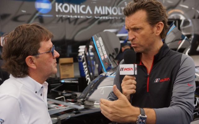 Justin Bell interviewing Wayne Taylor at Watkins Glen.  [Photo by Jack Webster]