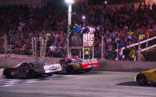 Start of the Slinger Nationals with former NASCAR Truck Series star Rick Crawford leading the field.  [Russ Lake Photo]