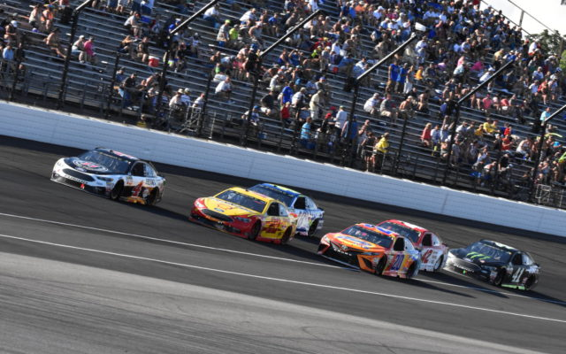 Kevin Harvick leads a pack out of turn four at Indianapolis,  [John Wiedemann Photo]
