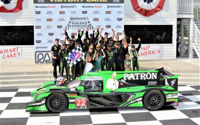 #22 Johannes Van Overbeek/Luis Felipe Derani, crew and families celebrate in victory lane after winning Prototype.  [Dave Jensen Photo]