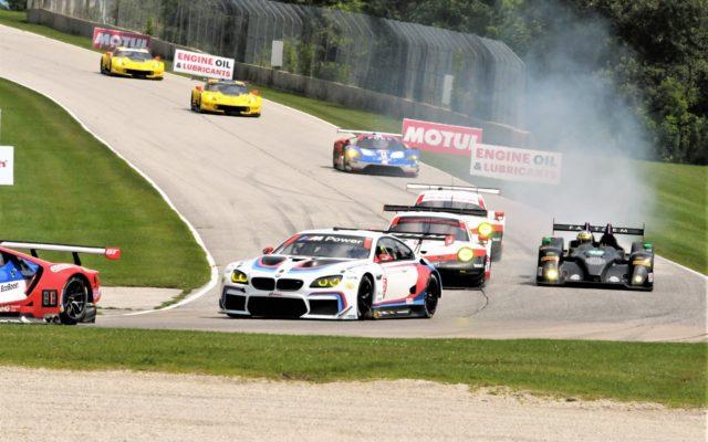 #26 Mark Kvamme/Gustavo Yacaman light the tires up coming into turn 3.  [Dave Jensen Photo]