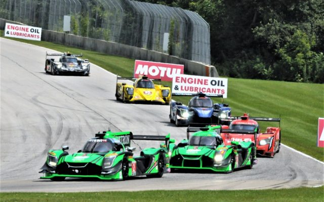 #2 Patron Tequila (Nissan DPI) leads a group into turn 3.  [Dave Jensen Photo]