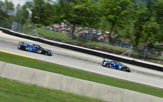 Canada Corner at Road America with the Acura NSX GT3 in front of the Ligier LMP2.  [John Wiedemann Photo]