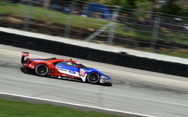 GTLM class winning Ford Chip Ganassi Racing Ford GT driven by Dirk Mueller and Joey Hand races out of turn 12 at Road America.  [John Wiedemann Photo]