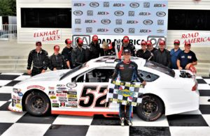Austin Theriault and crew in victory lane after winning the ARCA racing series presented by Menards event at Road America. [Dave Jensen Photo]
