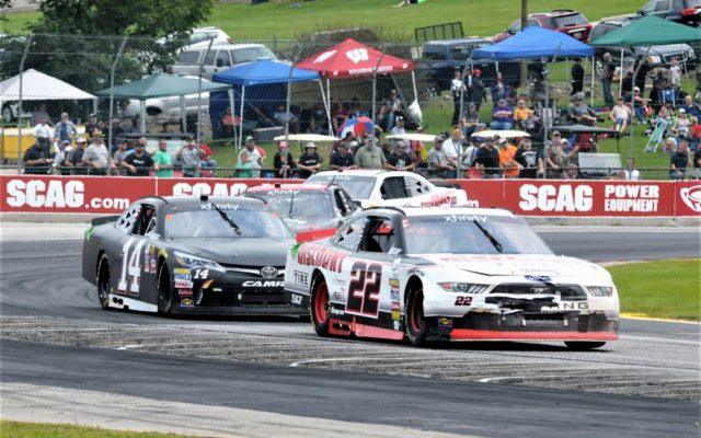 #22 Austin Cindric, #14 J.J. Yeley in turn 5 in NASCAR Xfinity race.  [Dave Jensen Photo]