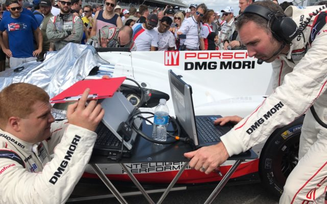 Final adjustments on the grid for Porsche.  [Photo by Eddie LePine]