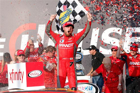 Justin Allgaier celebrates in victory lane after winning the NASCAR XFINITY Series TheHouse.com 300 at Chicagoland Speedway. [Credit: Sean Gardner/Getty Images]