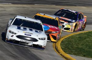 Brad Keselowski leads Kyle Busch and Chase Elliott during the Monster Energy NASCAR Cup Series STP 500 at Martinsville Speedway. [Photo by Jared C. Tilton/Getty Images]