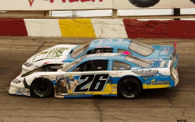 Chris Blawat in the low lane races with Dana Czach.  [Roy Schmidt Photo]