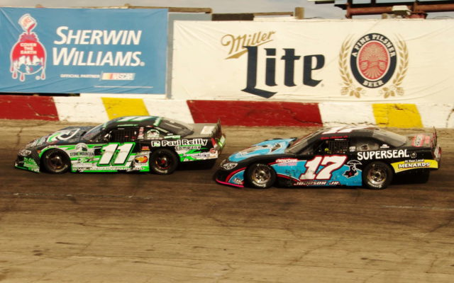 Alex Prunty leads ahead of Brian Johnson Jr  at the National Short Track Championship at Rockford Speedway.  [Roy Schmidt Photo]