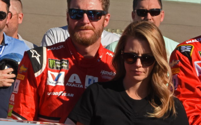 Dale and Amy Earnhardt shown during National Anthem activity.   [Joe Jennings Photo]