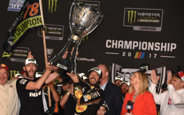 Flanked by crew chief cole Pearn Truex hoists heavy Monster Cup trophy.  [Joe Jennings Photo]