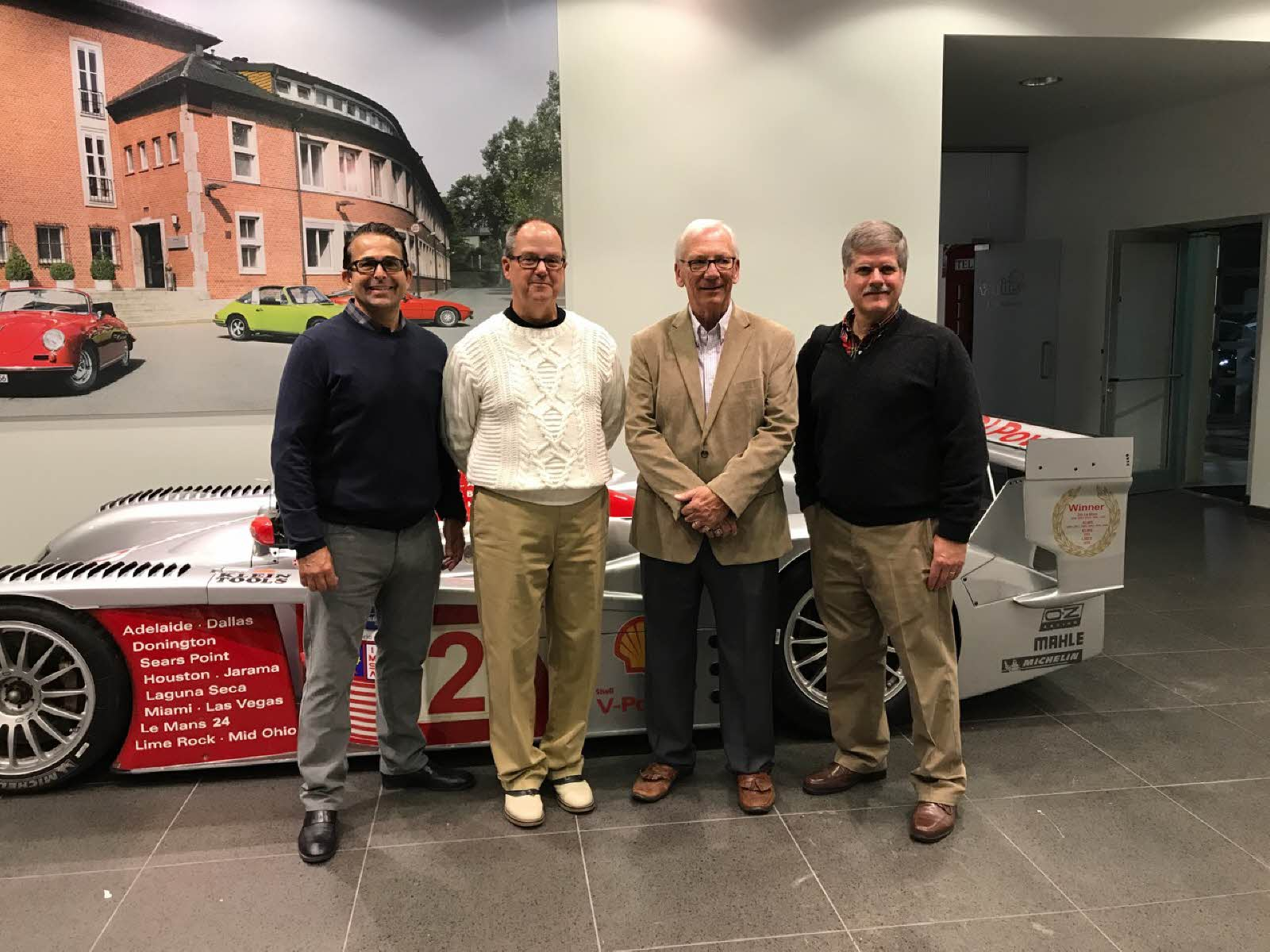 Eddie LePine, Tim Brookhart of White Allen, Jack Webster and David Pawlik by the Audi R8 at the book launch. [Jack Webster Photo]
