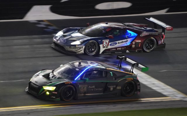 GTLM winning Ford GT passes Audi R8 during the night.  [Photo by Jack Webster]