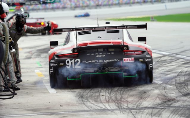 Porsche exits the pits at Daytona.  [Photo by Jack Webster]