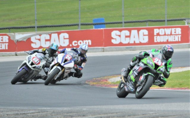 #24 Travis Wyman (BMW S 1000 RR), #28 Roi Holster (Yamaha YZF-R1 And #681 Dustin Dominguez (Kawasaki ZX-10R) in turn 5 in Stock 1000 class.  [Dave Jensen Photo]
