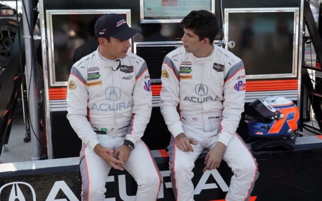 Castroneves and Taylor planning their race.  [Photo by Jack Webster]