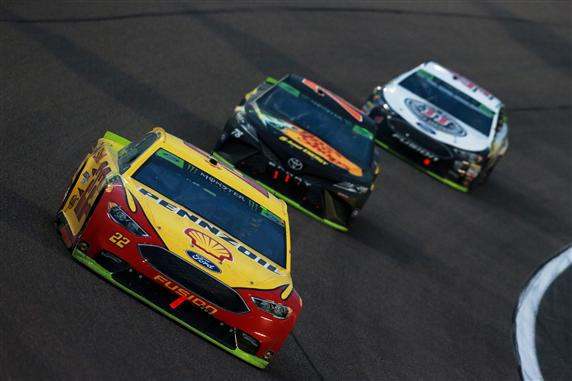 Joey Logano leads Martin Truex Jr. and Kevin Harvick during the Monster Energy NASCAR Cup Series Ford EcoBoost 400 at Homestead-Miami Speedway. [Credit: Sean Gardner/Getty Images]