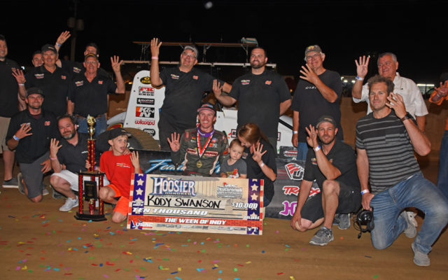 DePalma Motorsports team hold up 4 fingers as a result of winning the Hoosier 100 for the fourth year in a row.  [Joe Jennings Photo]