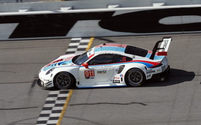 Porsche 911 RSR crossing the stripe.  [Photo by Jack Webster]