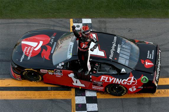 Michael Annett celebrates after winning the NASCAR Xfinity Series NASCAR Racing Experience 300 at Daytona International Speedway. [Sean Gardner/Getty Images]