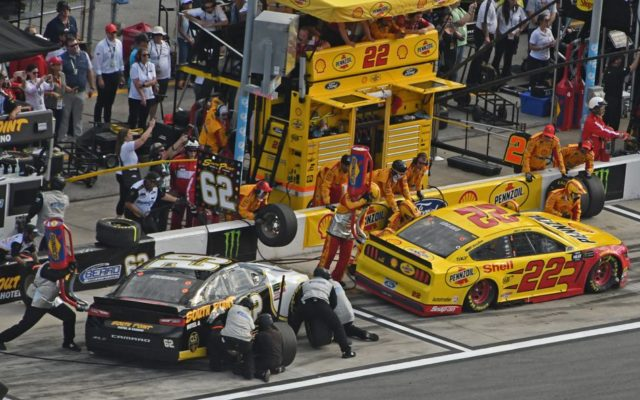 Pit stops in tight quarters for Brendan Gaughan and Joey Logano.  [Joe Jennings Photo]