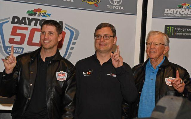 Champion driver Denny Hamlin, champion crew chief Chris Gabehart and champion car owner Joe Gibbs flash winning smiles.  [Joe Jennings Photo]