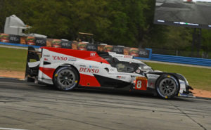 Fernando Alonso steers a Toyota Gazoo Racing Hybrid around the 3.74-mile course at Sebring.   Not only did Alonso and his teammates win the 1000 mile race but he set a qualifying record when he lowered the standard by 3 seconds. [Joe Jennings Photo}