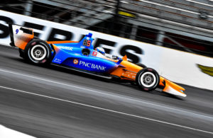 Scott Dixon into turn 1 of the road course at the Indianapolis Motor Speedway for the IndyCar Grand Prix. [John Wiedemann Photo]