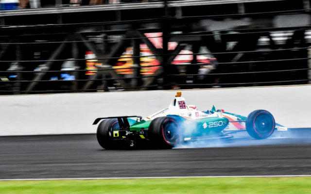 Kyle Kaiser spins through turn three in the Indianapolis 500.  [John Wiedemann Photo]