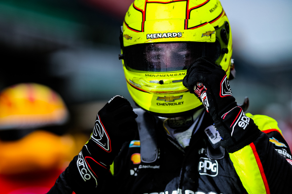 Simon Pagenaud climbs from his car after winning the INDYCAR Grand Prix. © [Andy Clary/ Spacesuit Media
