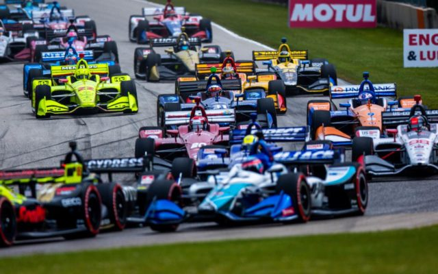 The pack on the opening lap in turn 3 at Road America.  © [Andy Clary/ Spacesuit Media]