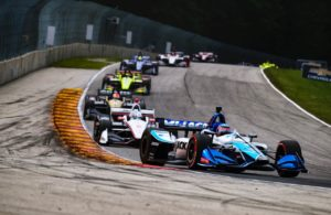 Takuma Sato leads a group through turn 5 at Road America. © [Jamie Sheldrick/ Spacesuit Media]