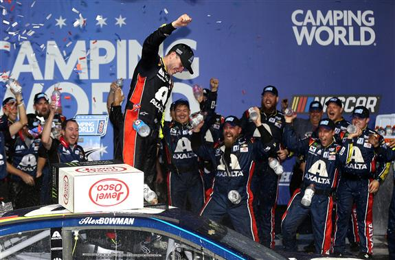 Alex Bowman celebrates in Victory Lane after winning the Monster Energy NASCAR Cup Series Camping World 400 at Chicagoland Speedway. [Credit: Matt Sullivan/Getty Images]