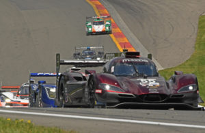 Mazda leads others in tightly bunched run into turn 7. [Joe Jennings Photo]